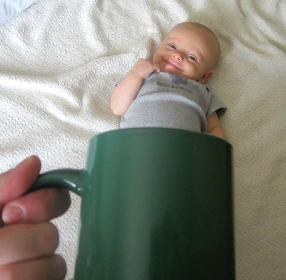 Baby mugging Facebook